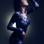 colour photo of model in Blue dress with her face half hidden by shadow