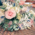 Bouquet of wedding flowers on table