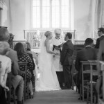 Bride and Groom stand during wedding ceremony