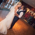 Couple dancing on dance-floor at wedding reception