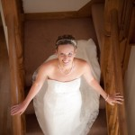 Bride in dress walking down stairs