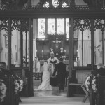 Wedding couple before altar at St. Cleer parish church
