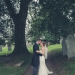 Couple kiss in church cemetary path