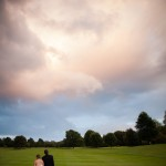 Wedding couple walk through field
