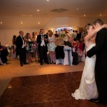 Wedding couple take first dance at hotel